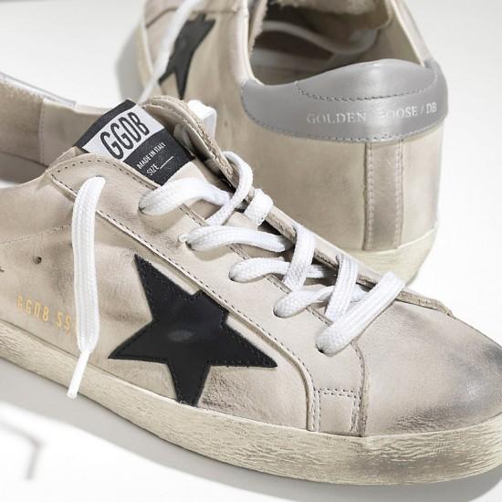 Men Golden Goose superstar in cream nabuk black sneaker
