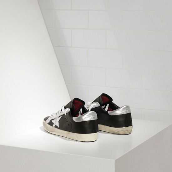 Men Golden Goose superstar in leather star black leather silver sneaker
