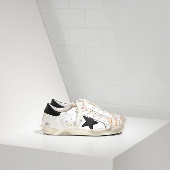 Women Golden Goose superstar in destroyed zebra sneaker