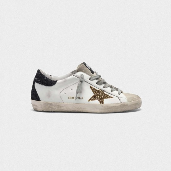 Women Golden Goose superstar with gold star and glittery black sneaker